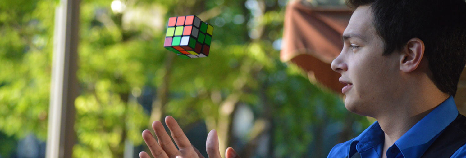 Magician Steven Brundage performs magic with a Rubik's Cube