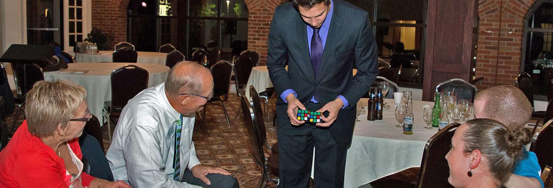 Magician Steven Brundage performing up-close magic at a private event