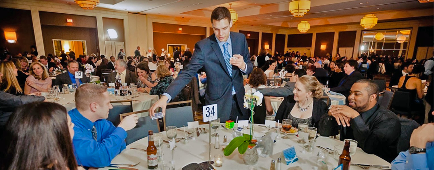 Magician Steven Brundage performing magic at a corporate event