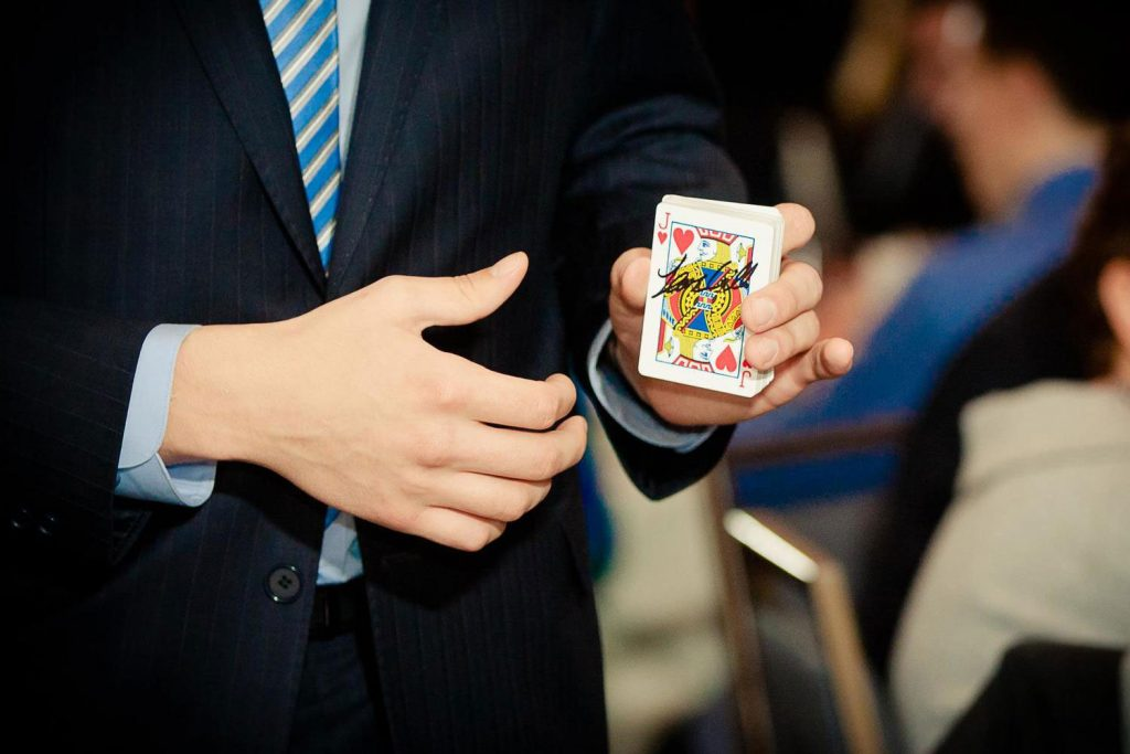 Magician Steven Brundage holding the Jack of Hearts card