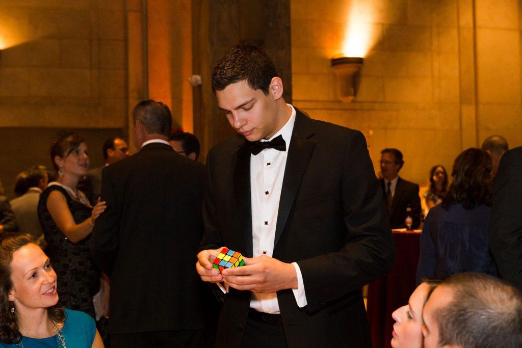 Magician Steven Brundage performing Rubik's Cube Magic at a corporate event